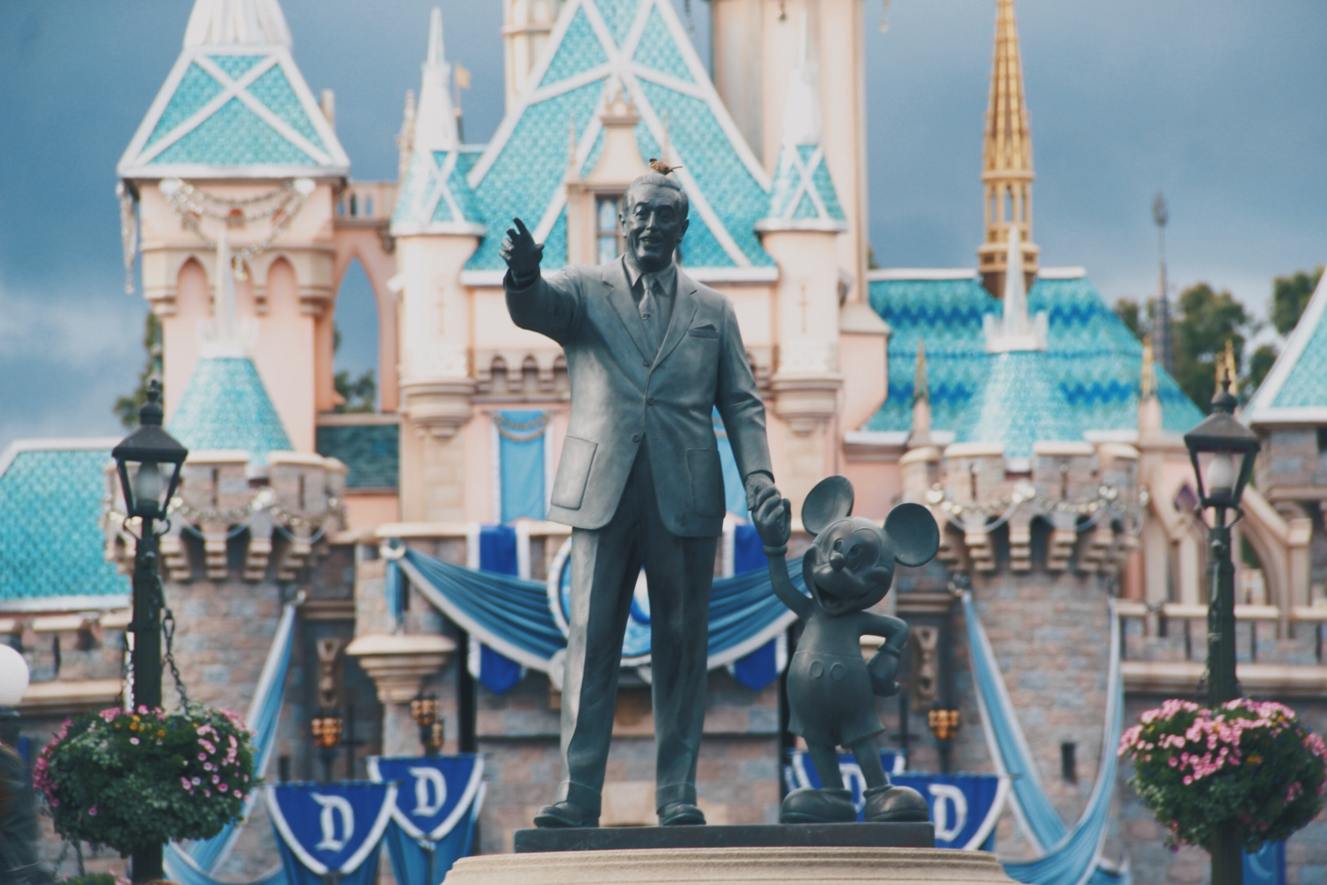 Disneyland on a budget. Walt Disney and Mickey Mouse in front of Cinderella's Castle
