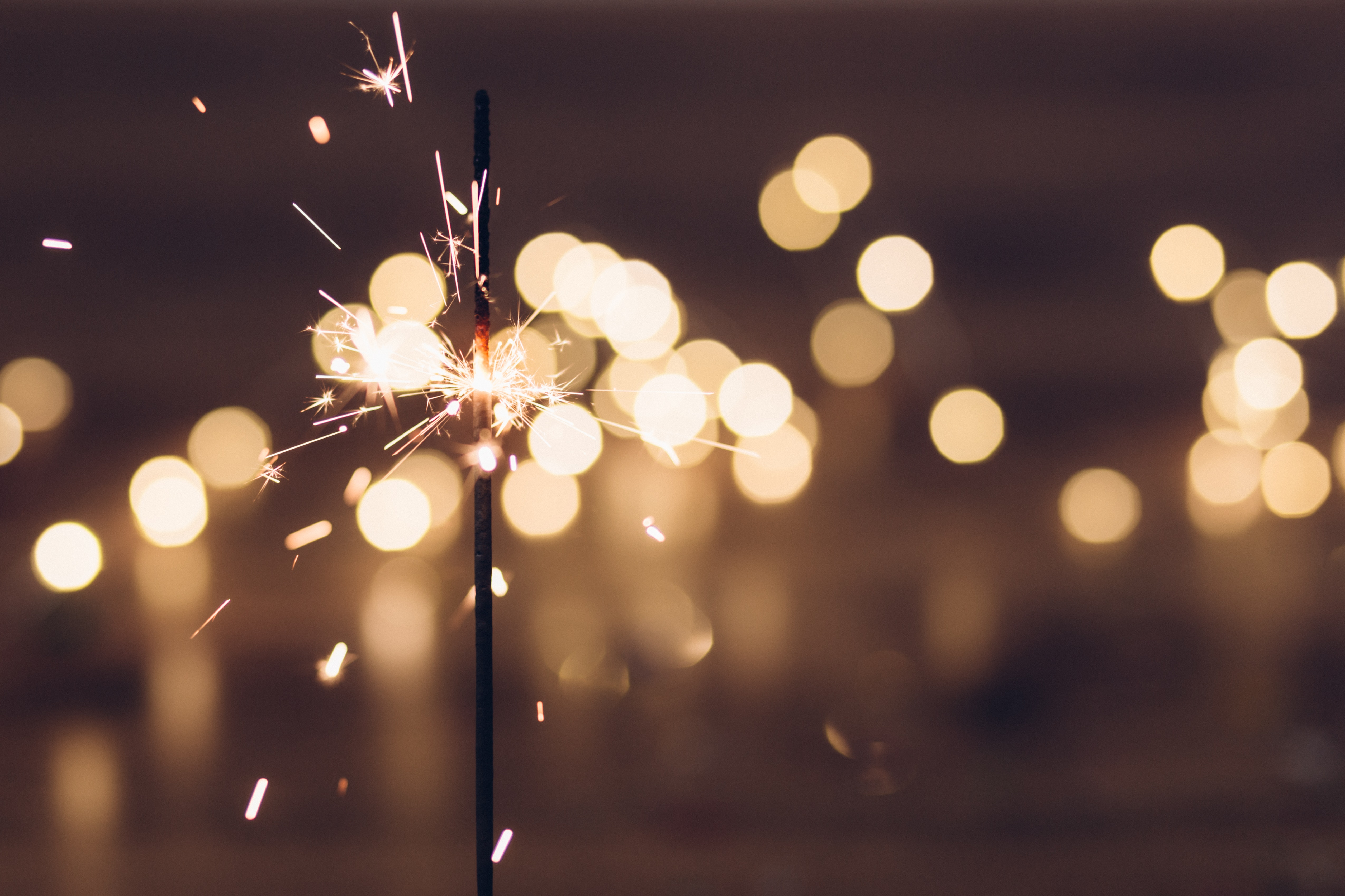 New Year's travel resolutions. New Years sparkler